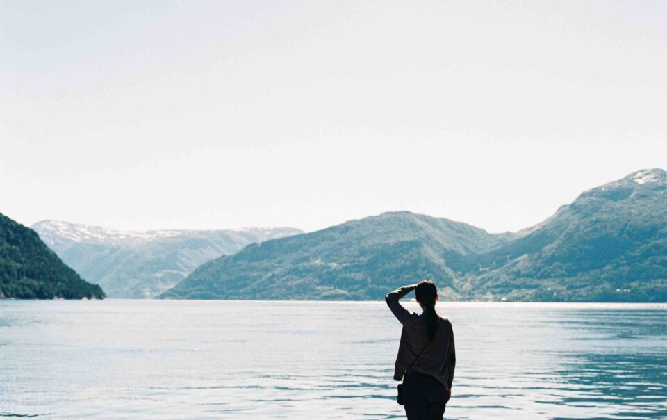 Woman looking at lake for post on breathing